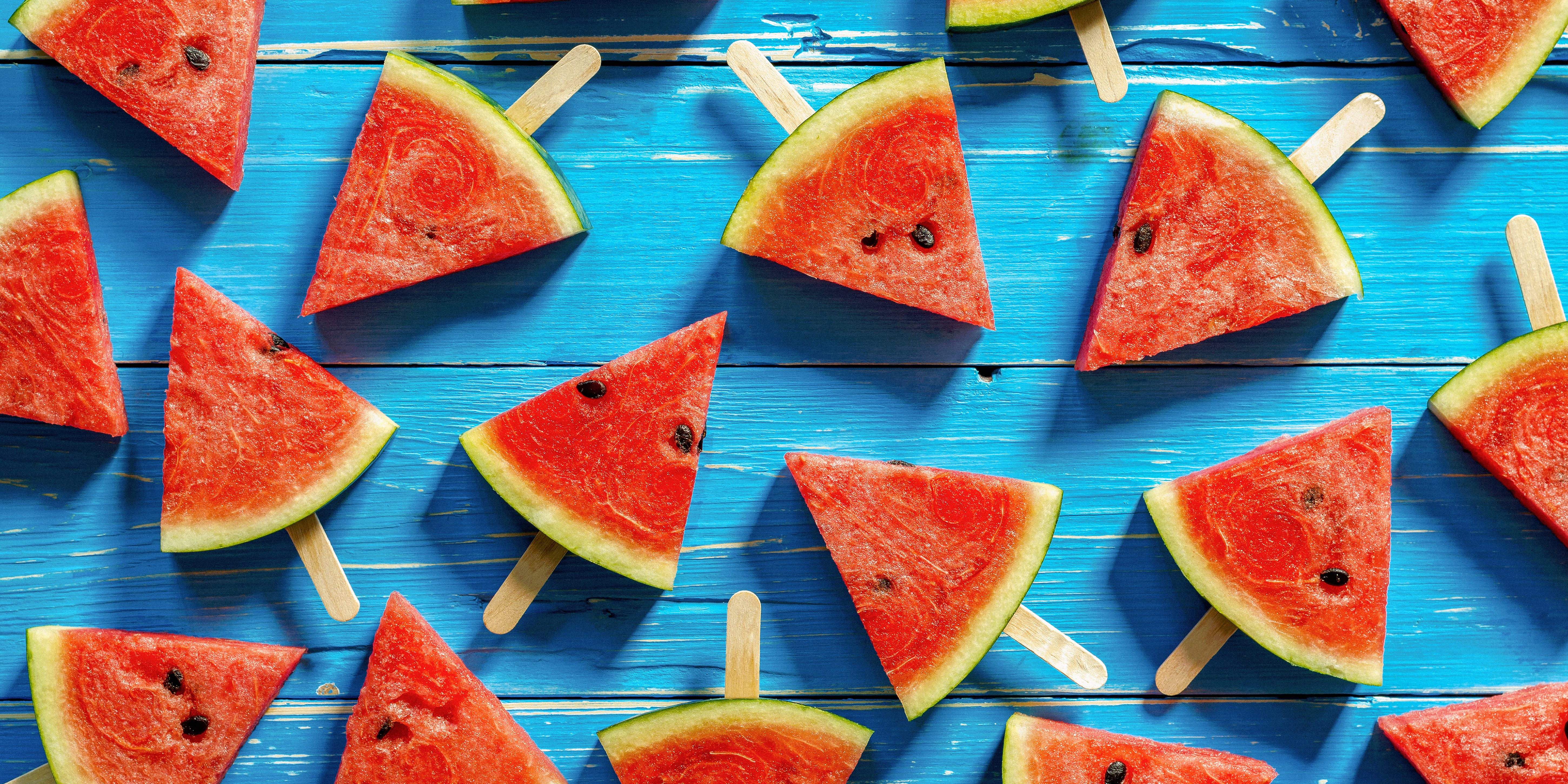 Watermelon,Slice,Popsicles,On,A,Blue,Rustic,Wood,Background